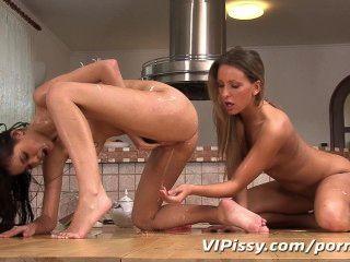 Lesbian Babes Sucking Up Piss Puddles