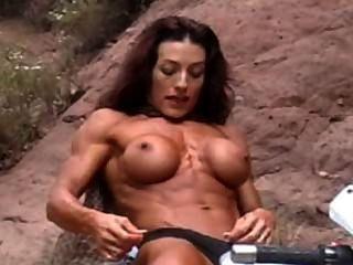 Topless Muscle Woman On A Bike Flexing