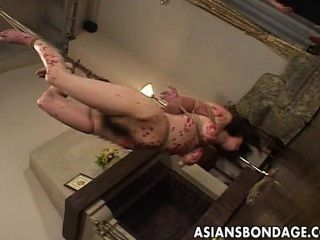 Busty Asian Gal Drenched In Wax